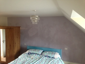 wall painted purple but not yet dry